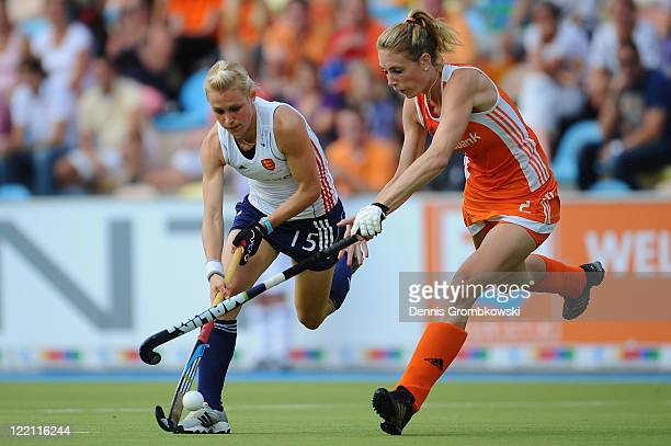 Alex Danson of England is challenged by Willemijn Bos of Netherlands during the Women's Eurohockey 2011 semi final match between Netherlands and...