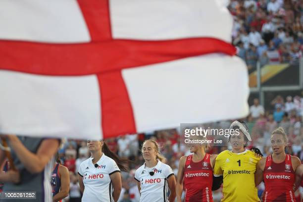 Alex Danson of England Maddie Hinch of England and Susannah Townsend of England sing their National Anthem during the Pool B game between USA and...