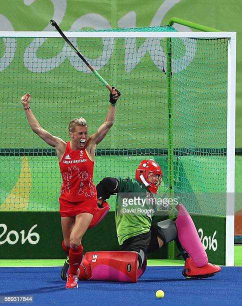 Alex Danson of Great Britain celebrates after scoring their second goal during the Women's group B hockey match between Great Britain and the USA on...