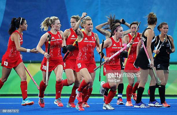 Alex Danson of Great Britain celebrates scoring the first goal during the Women's Semifinal match between New Zealand and Great Britain on Day 12 of...