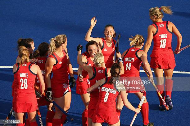 Alex Danson of Great Britain celebrates scoring the opening goal with her team mates during the Women's Hockey Pool WA Match W05 between Great...