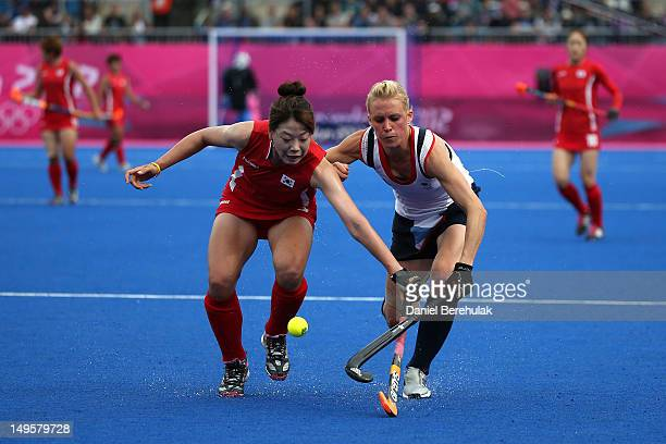 Alex Danson of Great Britain is challenged by Sena Cha of Korea during the Women's Hockey Match between Great Britain and Korea on day 4 of the...