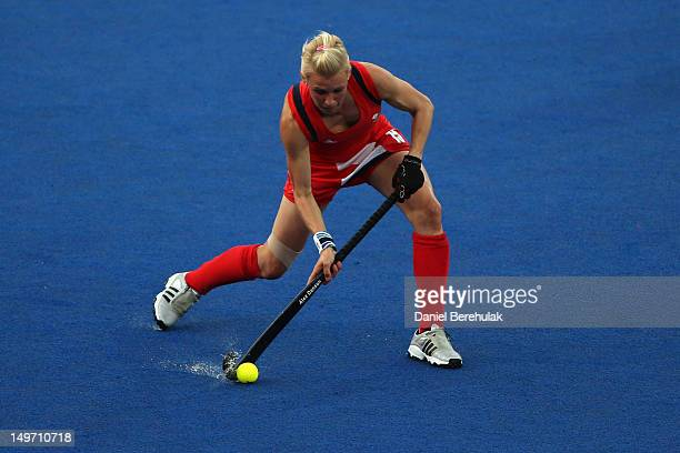 Alex Danson passes the ball in the Women's Hockey preliminary match between Belgium and Great Britain on Day 6 of the London 2012 Olympic Games at...