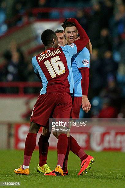 Alex Davey of Scunthorpe is congratulated by teammate Hakeeb Adelakun of Scunthorpe after scoring the opening goal during the FA Cup Third Round...