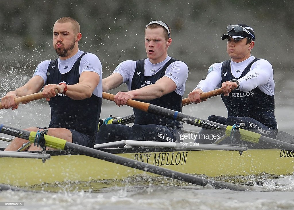 Alex Davidson, Geordie Macleod and Patrick Close (Bow) of The Oxford Blue Boat in action during the training race against German Eight on the River Thames on March 17, 2013 in London, England.