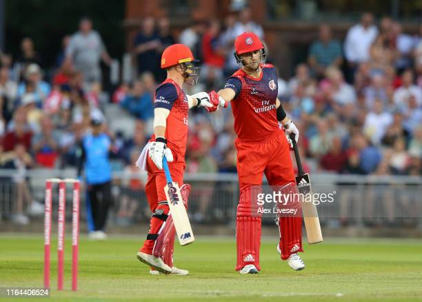 Alex Davies and Liam Livingstone of Lancashire Lightning touch gloves during the Vitality Blast match between Lancashire Lightning and Worcestershire...