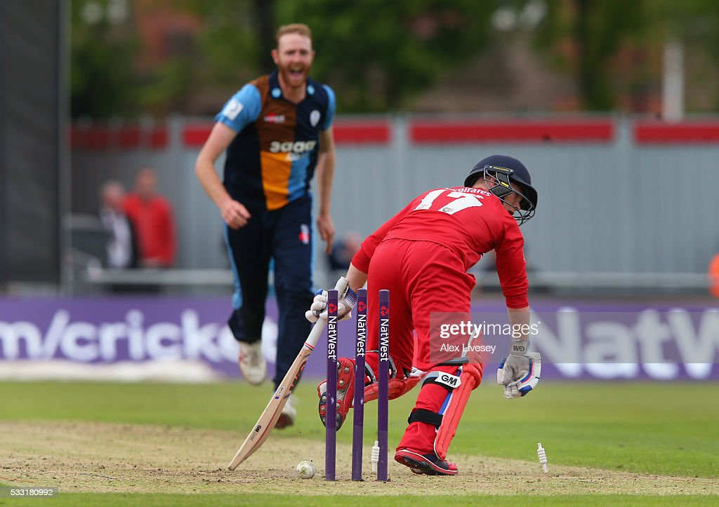 Alex Davies of Lancashire is bowled out by Andy Carter of Derbyshire during the NatWest T20 Blast between Lancashire and Derbyshire at Old Trafford on May 21, 2016 in Manchester, England.