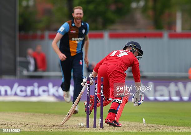 Alex Davies of Lancashire is bowled out by Andy Carter of Derbyshire during the NatWest T20 Blast between Lancashire and Derbyshire at Old Trafford...