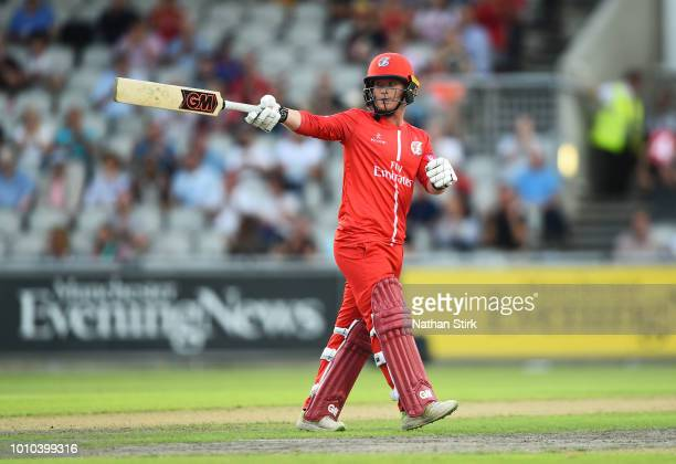 Alex Davies of Lancashire raises his bat after scoring 50 runs during the Vitality Blast match between Lancashire Lightning and Leicestershire Foxes...