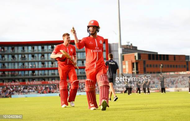 Alex Davies raises his bat as he walks off the pitch scoring 94 runs during the Vitality Blast match between Lancashire Lightning and Leicestershire...