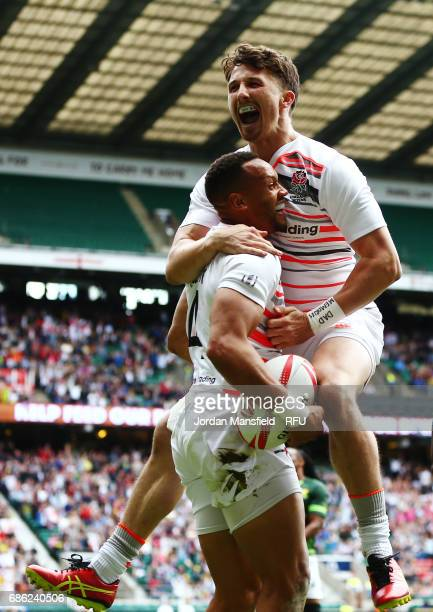 Alex Davis celebrates with Dan Norton of England after he touches down a try during the match between England and South Africa during day two of the...