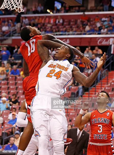 Alex Davis of the Fresno State Bulldogs and Casey Prather of the Florida Gators battle under the boards during the MetroPCS Orange Bowl Basketball...