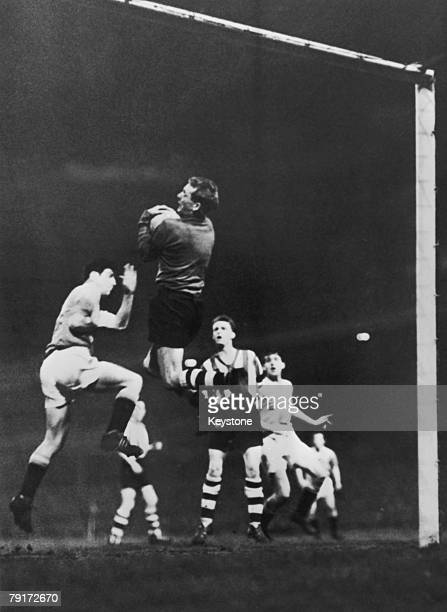Alex Dawson the Manchester United centre forward charges Ryall the Sheffield Wednesday goalkeeper resulting in a free kick against United February...