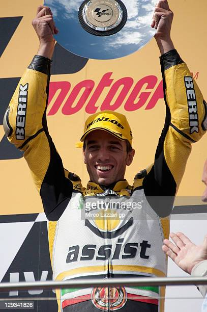 Alex De Angelis of Italy and JIR Moto2 celebrates on the podium the victory at the end of the Moto2 race of the Australian MotoGP which is round 16...