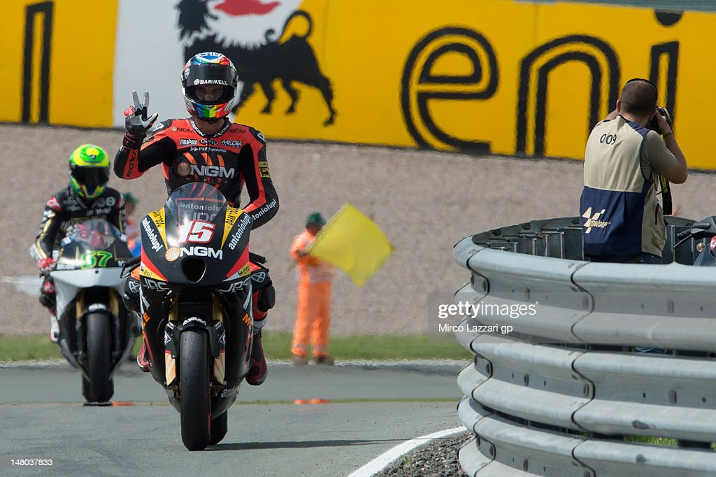 Alex De Angelis of Italy and NGM Mobile Forward Racing celebratescoming third at the end of the Moto2 race of the MotoGp of Germany at Sachsenring Circuit on July 8, 2012 in Hohenstein-Ernstthal, Germany.