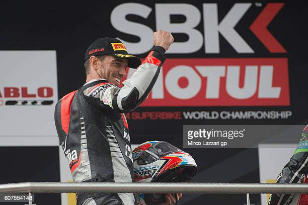 Alex De Angelis of Rep San Marino and IodaRacing Team celebrates the second place on the podium at the end of the World Superbike Race 2 during the...