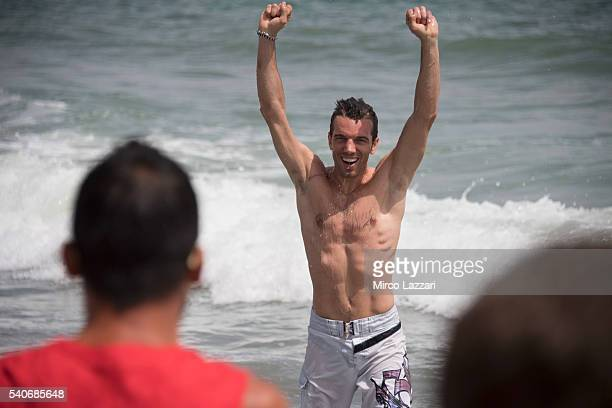 Alex De Angelis of Rep San Marino and IodaRacing Team greets during the preevent on the beach in Misano Adriatico during the FIM Superbike World...