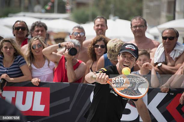 Alex De Angelis of Rep San Marino and IodaRacing Team plays on the sand during the preevent on the beach in Misano Adriatico during the FIM Superbike...