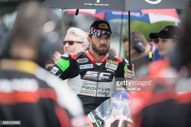 Alex De Angelis of Rep San Marino and Pedercini Racing prepares to start on on the grid during the Superbike Race 2 during the FIM Superbike World...
