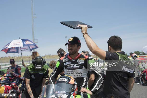 Alex De Angelis of Rep San Marino and Pedercini Racing prepares to start on the grid during the Superbike Race 1 during the FIM Superbike World...