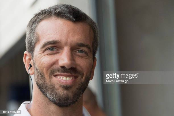 Alex De Angelis of San Marino smiles in pit during the MotoGp of Austria Free Practice at Red Bull Ring on August 10 2018 in Spielberg Austria