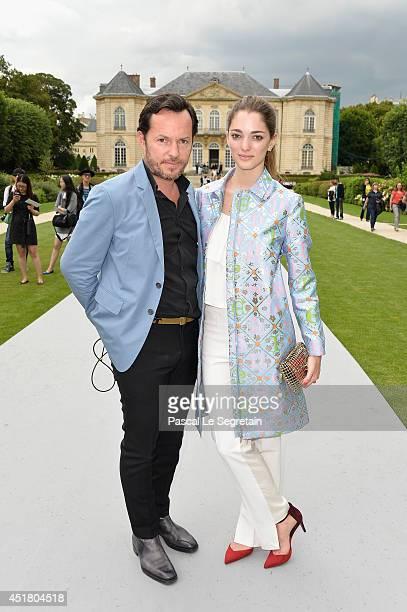 Alex de Betak and Sofia Sanchez Barrenechea attend the Christian Dior show as part of Paris Fashion Week Haute Couture Fall/Winter 20142015 on July 7...