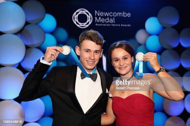 Alex de Minaur and Ashleigh Barty pose with the the Newcombe Medal during the Newcombe Medal at Crown Entertainment Complex on November 26 2018 in...