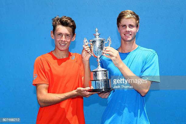 Alex De Minaur and Blake Ellis of Australia pose with the championship trophy after winning their Junior Boys' Doubles Final match against Lukas...