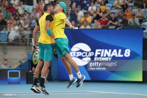 Alex de Minaur and Nick Kyrgios celebrate winning match point during their quarter final doubles match against Jamie Murray and Joe Salisbury of...