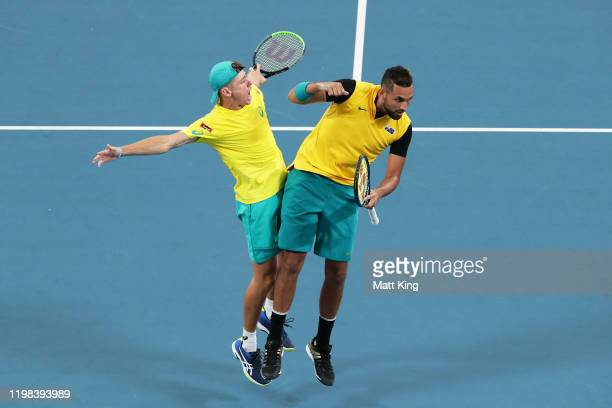 Alex de Minaur and Nick Kyrgios of Australia celebrate winning a point in their quarter final doubles match against Jamie Murray and Joe Salisbury of...