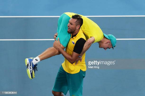 Alex de Minaur and Nick Kyrgios of Australia celebrate winning match point in their quarter final doubles match against Jamie Murray and Joe...