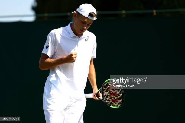 Alex De Minaur of Australia celebrates a point against Marco Cecchinato of Italy during their Men's Singles first round match on day two of the...