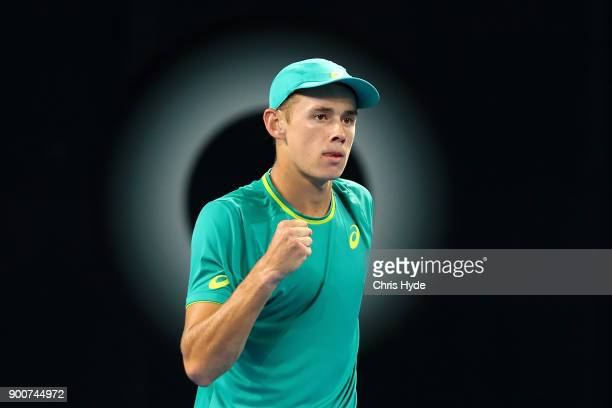 Alex De Minaur of Australia celebrates a point in his match against Milos Raonic of Canada during day four of the 2018 Brisbane International at Pat...