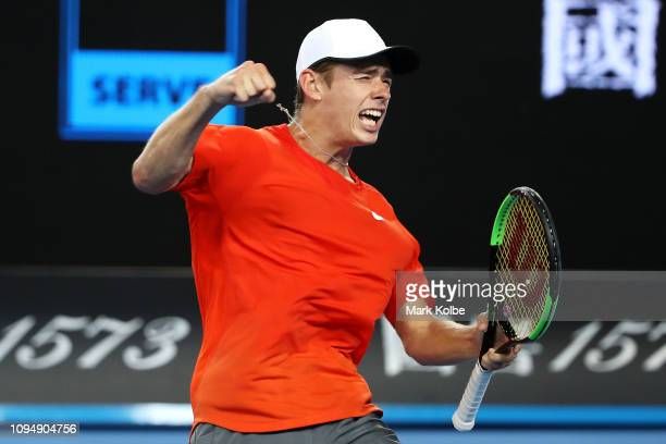 Alex De Minaur of Australia celebrates match point in his second round match against Henri Laaksonen of Switzerland during day three of the 2019...