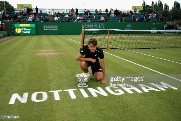Alex De Minaur of Australia celebrates victory in the Mens Singles Final during Day Nine of the Nature Valley Open at Nottingham Tennis Centre on...
