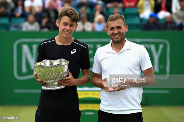 Alex De Minaur of Australia celebrates victory with runner up Dan Evans of Great Britain in the Mens Singles Final during Day Nine of the Nature...