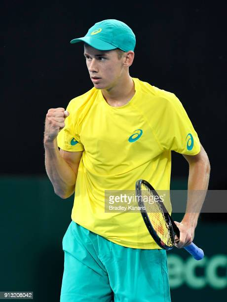 Alex de Minaur of Australia celebrates winning a point against Alexander Zverev of Germany during the Davis Cup World Group First Round tie between...