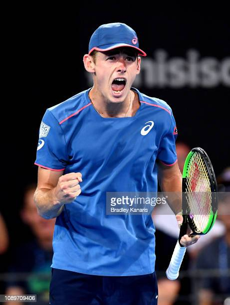 Alex De Minaur of Australia celebrates winning a point in his match against Jo-Wilfried Tsonga of France during day six of the 2019 Brisbane...