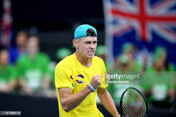 Alex de Minaur of Australia celebrates winning a point in his match against Denis Shapovalov of Canada during day three of the 2020 ATP Cup Group...