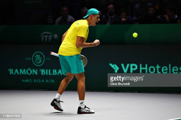 Alex De Minaur of Australia celebrates winning a point in his quarter final singles match against Denis Shapovalov of Canada during Day Four of the...
