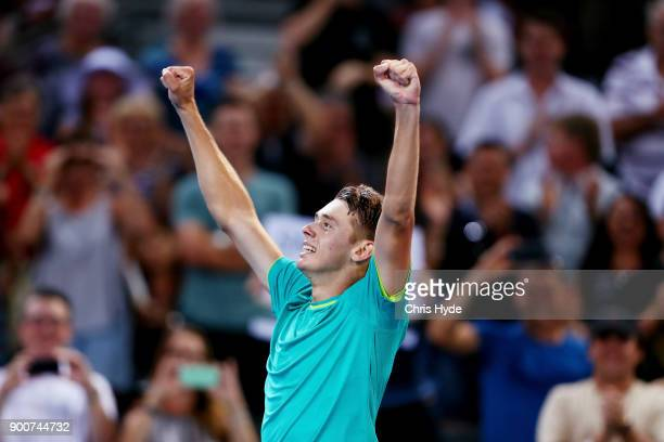 Alex De Minaur of Australia celebrates winning his match against Milos Raonic of Canada during day four of the 2018 Brisbane International at Pat...