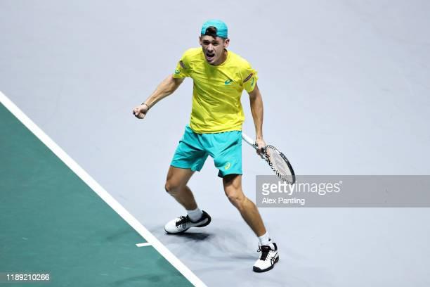 Alex De Minaur of Australia celebrates winning his match in his quarter final singles match against Denis Shapovalov of Canada during Day Four of the...