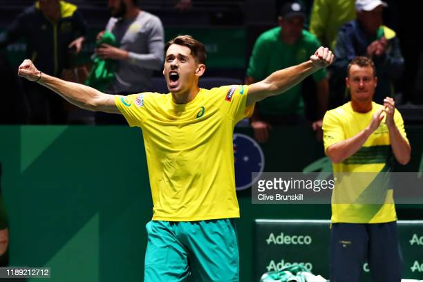 Alex De Minaur of Australia celebrates winning his match in his quarter final singles match against Denis Shapovalov of Canada during Day Four of the...