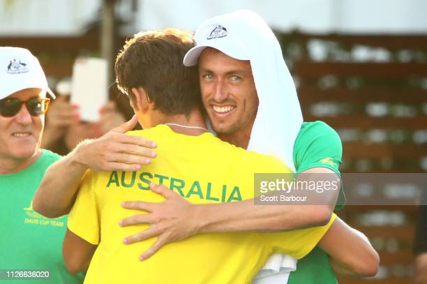 Alex de Minaur of Australia celebrates with John Millman of Australia after winning his rubber 2 singles match against Mirza Basic of Bosnia /...