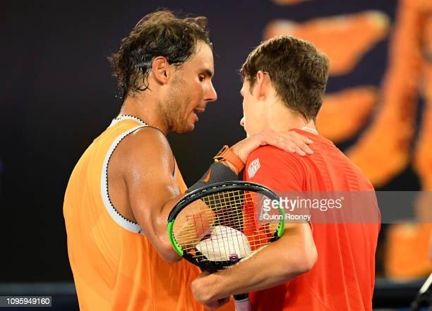Alex De Minaur of Australia congratulates Rafael Nadal of Spain at the net after losing his third round match against Rafael Nadal of Spain during...