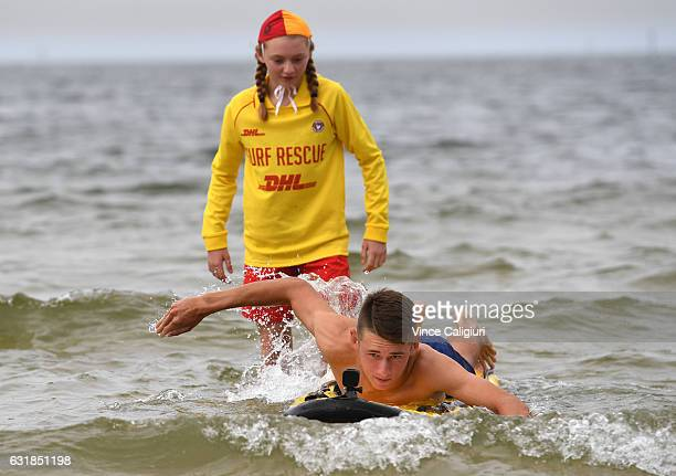 Alex De Minaur of Australia getting some lessons from the Sth Melbourne Life Saving club during day two of the 2017 Australian Open at Melbourne Park...