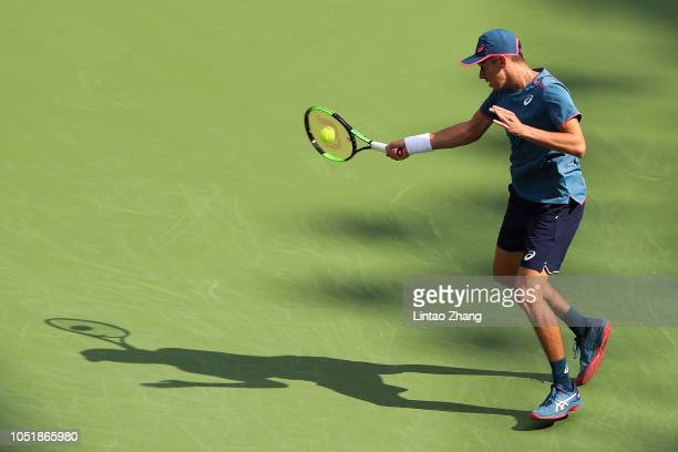 Alex De Minaur of Australia hits a return against Alexander Zverev of Germany during they third round of the 2018 Rolex Shanghai Masters on Day 5 at...