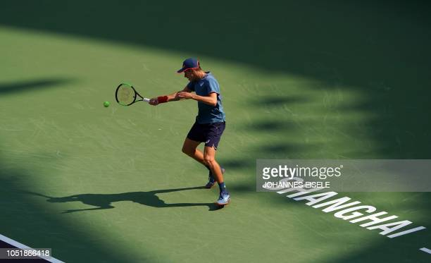 Alex de Minaur of Australia hits a return against Alexander Zverev of Germany during their men's singles third round match at the Shanghai Masters...