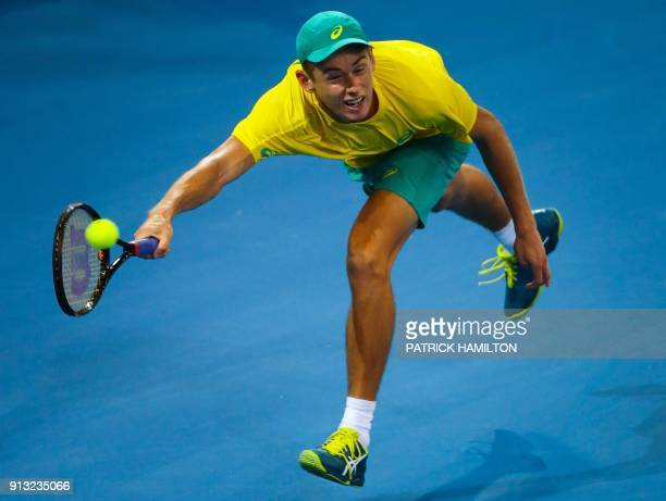 Alex De Minaur of Australia hits a return against Alexander Zverev of Germany during their men's singles tennis match in the Davis Cup World Group...