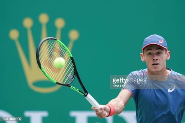 Alex De Minaur of Australia hits a return againstAlexander Zverev of Germany during third round of the 2018 Rolex Shanghai Masters at Qi Zhong Tennis...